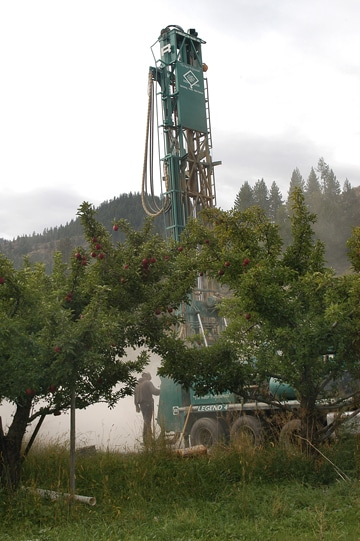 "A test well was drilled in the orchard behind Hanks' Harvest Foods in Twisp last week as part of the Methow Valley Irrigation District's ""Instream Flow Improvement Project."" Drilling was suspended this week because of the federal government shutdown. Photo by Ann McCreary"