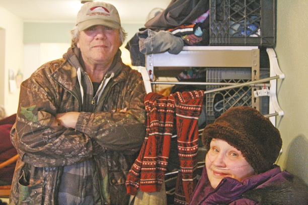 """Rob Hood and Cheri Corriel travel to The Cove from the lower valley because they appreciate the friendly atmosphere. """"It's the people, not so much the food,"""" said Hood. Photo by Marcy Stamper"""