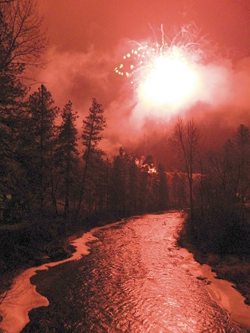 The Chewuch River was dramatically illuminated by the Christmas at the End of the Road fireworks display. Photo by Mary Kiesau
