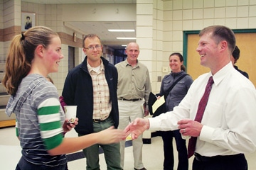 Tom Venable greets Liberty Bell High School ASB president Kathleen Chavey-Reynaud while Erik Brooks, Hanz Scholz and Sarah Brooks listen in, at a public forum after Venable was named superintendent of the Methow Valley School District. Photo by Marcy Stamper