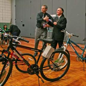 Scanning the crowd for the next winner of the bike raffle sponsored by the local Masonic Lodge are Dr. Brian Patrick, MVE principal, left, and Clayton King, Worshipful Master of Methow Valley Lodge 240 of the Free and Accepted Masons. Photo by Darla Hussey