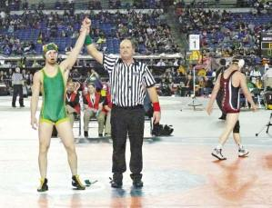 Milo Holston, above, finished off the scoring for Liberty Bell High School by taking first place in the 160-pound division at Mat Classic XXVI last weekend in the Tacoma Dome. That was more than enough for the Mountain Lions to claim their second straight 1B/2B championship, as Liberty Bell easily outdistanced Kittitas. Photo by Callie Fink