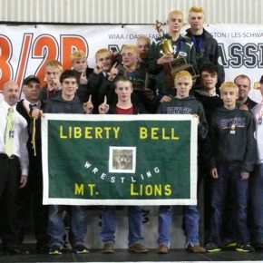 The Liberty Bell High School wrestling team and coaches celebrated a second straight state 1B/2B wrestling championship at Mat Classic XXVI last weekend in the Tacoma Dome. Photo by Callie Fink