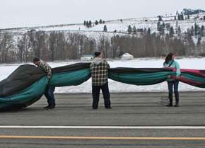 The crew gets a little help with the balloon-flattening process. Photo by Darla Hussey