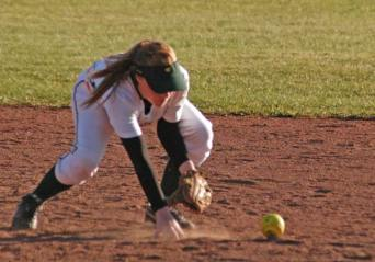 Second baseman Katherine Tannehill bobbles a ground ball off the bat of a Lake Roosevelt hitter. Tannehill's throw to first base was late due to the position of the field umpire, who blocked Tannehill's view of the ball. Interference was called and the runner was ruled out at first base. Photo by Mike Maltais