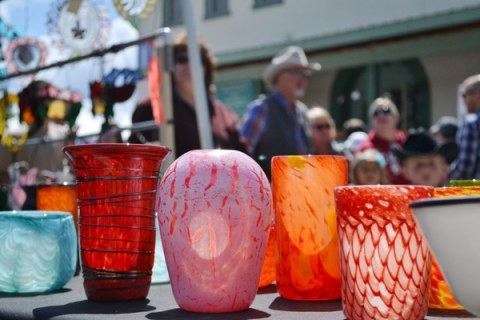 Glowing glassware by Terry Olson was among the offerings at last summer's Farmers Market. Photo by Laurelle Walsh
