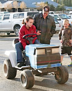 """Kristy Viteh, an MVES sixth-grader, built an electric-powered go-kart. She worked with her mom to gut an old mower and, according to Kristy, """"hook up an electric motor using a bunch of wires and it just worked."""" Photo by Darla Hussey"""
