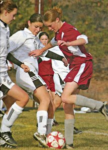 Regan Walsh, left, and Kelsey Bourn battle an Okanogan opponent for control of the ball in a 2004 regular season game. MV News archive photo