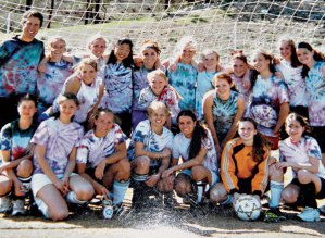 """A group of girls, including many of the founding team members, decked out in practice """"uniforms"""" they made themselves."""
