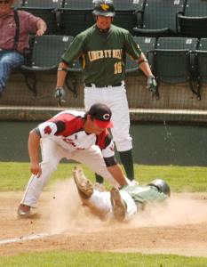 As teammate David Dinsmore III watches, Derek Alumbaugh slides safely home during district playoff action against White Swan on Thursday (May 15) at Wenatchee Valley College. Liberty Bell won the game, 16-0, and advances to the regional round at Walla Walla next weekend. Photo by Mike Maltais