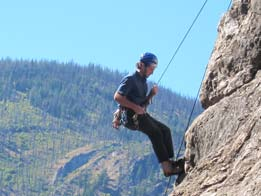 An unidentified climber (let us know if you know who he is) rappels down a route on Fun Rock at the climbing area on Lost River Road near Mazama on Sunday. Several groups of climbers took advantage of excellent weather to tackle the rock face. Photo by Don Nelson