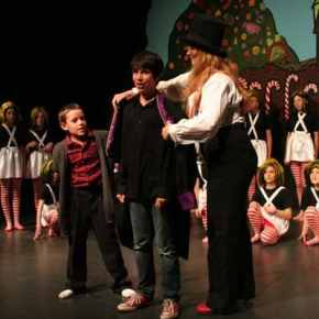 In the end, Wonka (Morgan Tate) rewards Charlie's (Myles Davis) good choices and ethical behavior by giving him the factory. Charlie's grandfather (Nicholas White) and the Oompa-Loompas look on. Photo by Darla Hussey