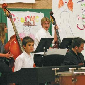 """The Jazz band enjoys playing """"Sunday Morning."""" Front, left to right: Michael Mott and Evan Wagstaff; Back, left to right: Kelsey Baldwin and Isaac Cordes. Photo by Darla Hussey"""