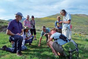 Kiesau (crouching) explains some botanical wonder to Dave Clement, left, Ferlito, Karen Fischer, Melinda Pruett, Weinstein, Charles Pruett and Betsy Weiss. Photo by Laurelle Walsh