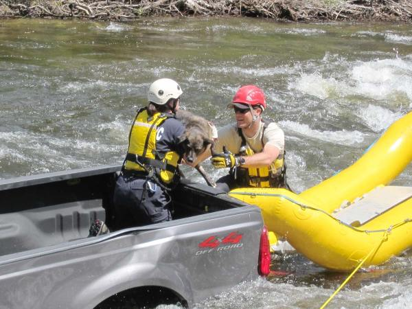 Vikki Buzzard, left, and Ottis Buzzard of the county's Swiftwater Rescue Team retrieved Jessie from the back of a truck that had rolled into the Chewuch River in Winthrop on Saturday (May 31). Photo by Don Nelson