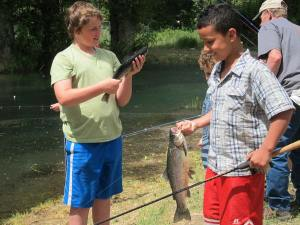 Nathaniel Batson of Twisp, left, and Merek Johnson of Twisp compare catches. Photo by Don Nelson