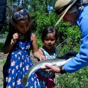 Veterinarian Betsy Devin Smith helps Abby and Kayla Morell get acquainted with a trout's anatomy. Photo by Laurelle Walsh/i>