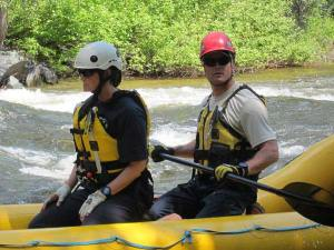 Vikki and Ottis Buzzard head downstream in the rescue raft. Photo by Don Nelson