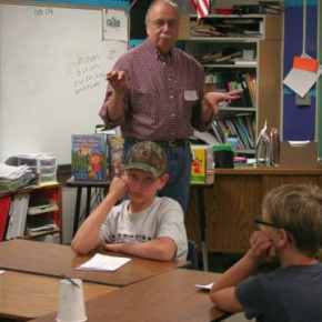 From left, Tyler and Madison listen to Don Nelson, the editor of the Methow Valley News. Photo by Darla Hussey