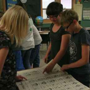 From left, Alexys, Dalynn, and Madison looked at the bound newspapers from 1995. Photo by Darla Hussey