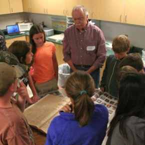 The fifth and sixth graders enjoyed looking at issues of the Methow Valley News from 100 years ago. Photo by Darla Hussey