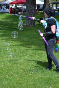 Jessica Marker blows bubbles in the park. Photo by Laurelle Walsh