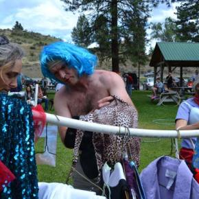 """""""Dresser"""" Laura Gunnip assists competitor Clark Youmans in the Drag King/Queen race. Photo by Laurelle Walsh"""