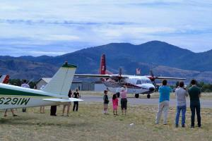 After eight smokejumpers made safe landings on the grassy field, their plane landed at the field for people to look at. Photo by Laurelle Walsh