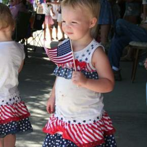 Madelynn Budrow, daughter of Aimee and Paul Budrow, anxiously awaits the beginning of the parade. Photo by Darla Hussey