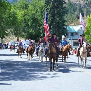 Members of the Methow Valley Horsemen, led by Ray Campbell and Dennis Gardner, ride tall down Glover Street. Photo by Laurelle Walsh