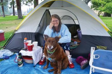 Shannon Aikins and her dog Sarah have set up camp in Winthrop's Mack Lloyd Park, and are receiving assistance from the Red Cross shelter in the Barn.Photo by Laurelle Walsh