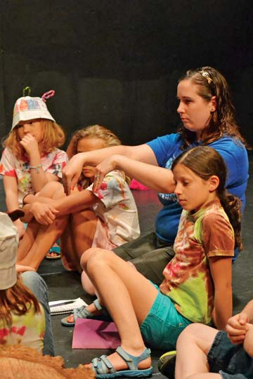 Merc Playhouse drama camp teacher Megan Fox Hicks helps campers with the finer points of choreography before a performance in July. Photo by Laurelle Walsh