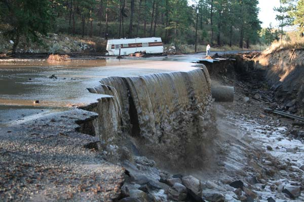 Thursday night's deluge washed away a large section of Highway 153 near milepost 27 south of Twisp. Photo by Darla Hussey
