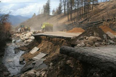Crews from the Washington Department of Transportation worked to create temporary passage where Frazer Creek surged and took out large chunks of the roadway a few miles up the Loup highway from the Methow Valley. Photo by Marcy Stamper, Methow Valley News