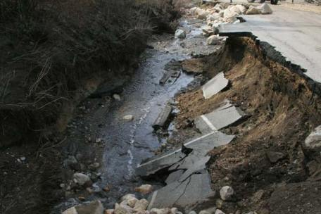 Below, large sections of pavement, formerly part of Highway 20 going over the Loup, fell into the deep crevasse carved by surging Frazer Creek. Photo by Marcy Stamper