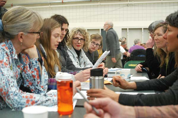 Photo by Ann McCreary Voters in the Twisp Rural precinct discuss guidelines on how to tally votes as the Democratic Party caucuses got underway Saturday (March 26) at Liberty Bell High School.