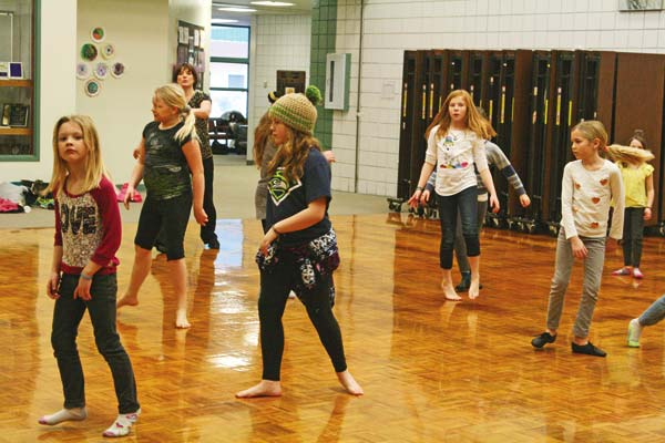 Photo by Marcy Stamper The spirited members of the dance club loosened up and worked on their rhythm and dance steps at a rehearsal last month.