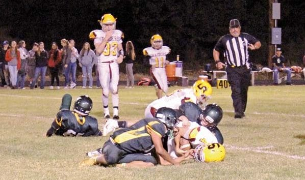Photo by Don Nelson Liberty Bell defenders pinned a Lake Roosevelt runner to ground at last Friday's game.