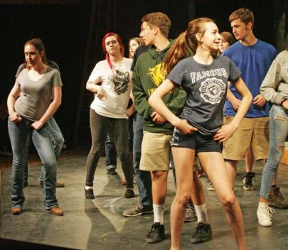 Photo by Marcy Stamper Footloose cast members practiced one of their exuberant line dances at a rehearsal last week.