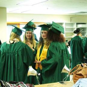 Photo by Darla Hussey Prior to the ceremony, graduates gathered in a classroom to give each other moral support as well as assistance donning their caps and gowns.