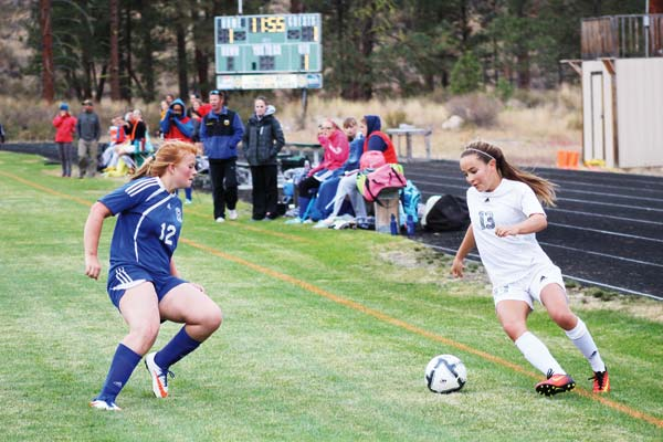 Photo by Don Nelson Sally Thornton-White, No. 13, scored Liberty Bell's first goal against Tonasket.