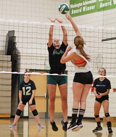 Photo by Don Nelson The LBHS volleyball team was aggressive at the net during a recent practice.