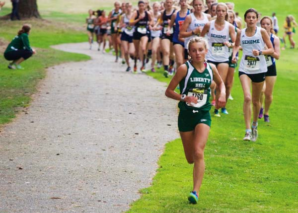 Photo by Erik Brooks Liberty Bell's Novie McCabe led the way at about the one-mile mark in the varsity girls' race.