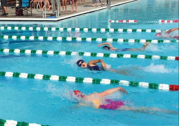 Photo courtesy of Amanda Remsberg Killer Whale swimmers — from bottom to top — Juliana Floyd, Helaina Remsberg and Nyah Franz competed in the girls' 7-8 25-yard freestyle, won by Remsberg.