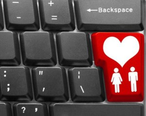 """Computer keyboard  with red """"Love"""" symbol"""