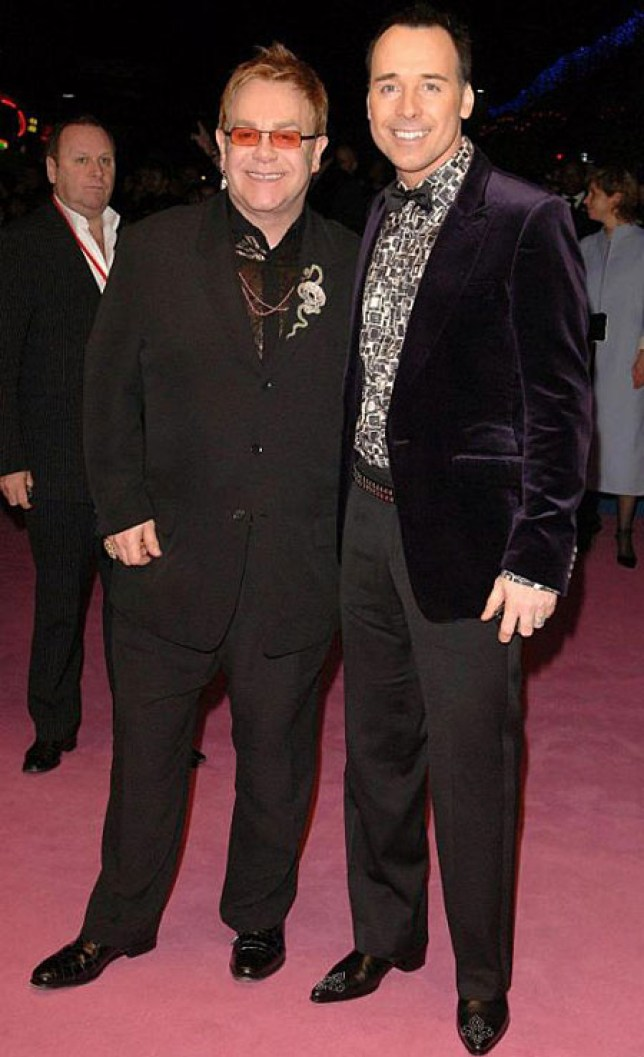 Elton John and husband David Furnish have ended their feud with Madonna (Picture: File)
