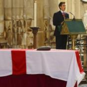 Mourners cheer for World Cup hero