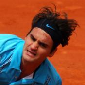 Federer into last four