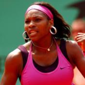 Henin hammering shocks Serena