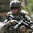 US apologises over Koran shooting